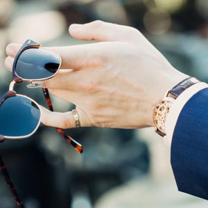 Sunglasses in hand